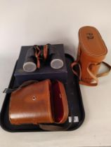 A leather cased pair of binoculars 10x50 by Carton with box plus a pair of Prinz 8x40 binoculars
