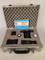 A Practica camera and lenses in case