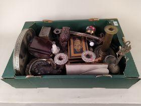 A box of mixed metal wares including candlesticks, a cash tin,