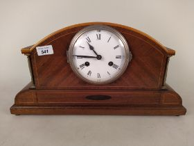 An Edwardian inlaid mahogany striking mantel clock