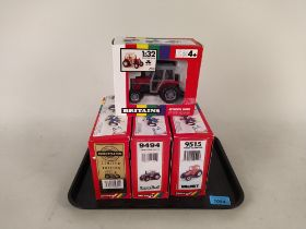 Four boxed Britains 1:32 scale models including 9502 Massey Ferguson tractor,