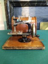 A vintage 'Lead' mini sewing machine in box