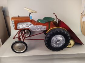 A 1960's Triang metal and plastic ride on tractor with trailer,