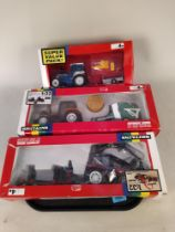 Three boxed Britains 1:32 scale models including 9656 Renault TX16 tractor and baler,
