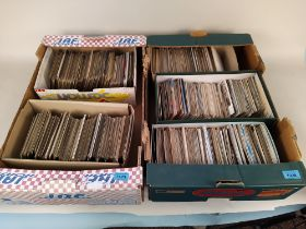 Two boxes with a large collection of vintage postcards