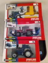 Three boxed Britains 1:32 scale models including 9508 Ford TW25 tractor,