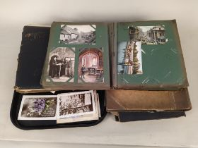 Five early postcard albums, well filled with early 20th Century cards,