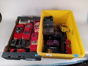 Two boxes of mainly Burago large model cars,