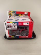 Three boxed Britains 1:32 scale models including 9500 Massey Ferguson,