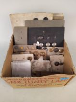 A box of carded 19th Century livery buttons, some have family name details, brass and white metal,