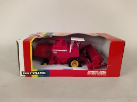 Britains 1:32 scale models including 9570 Massey Ferguson and 760 combine harvester (box lacking