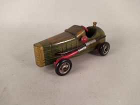 A hand built and painted wooden toy car,