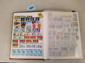 A stock book of commonwealth stamps, part filled including India, Guiana,