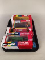 Four boxed Britains 1:32 scale models including 9559 yard brush, 9433 four trax and log shed,