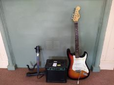 Fender Squire 'Strat' electric guitar with stand and amp