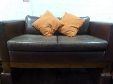 * 2 x distressed red leather sofas with throw cushions 1500w x 800d x 700h