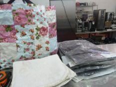 * bag of misc textiles - oven cloths, black shirts, etc