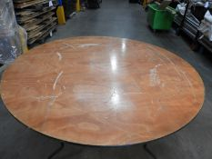 """*Stillage Containing Sixteen 5'6"""" Circular Banqueting Tables with Folding Legs"""