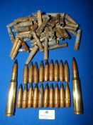 Inert 50 Caliber Rounds and Quantity of Armour Piercing 50 Caliber Bullet Heads 303 Cases