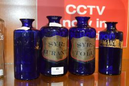 Four Blue Victorian Apothecary Bottles