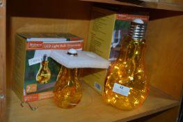 Two LED Light Bulb Ornaments