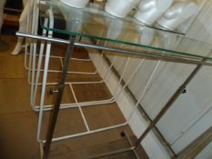 * chrome freestanding hanging rail on castors with glass top (adjustable height) 1450w x 500d