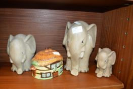 Three Pottery Elephants and a Cottage