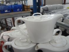 *7 x large white teapots