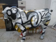* large statement piece - life sized fiber glass cow - with grafiti. From high end steak house.