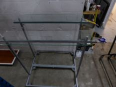 * 2 x metal rails with glass over shelf on castors. Adjustable height. 1600w x 500d x 1400h (min)
