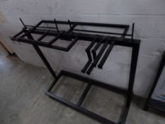 * black metal hanging rail on castors with 7 removable rails to suit various set-ups. 1500w x 600d x