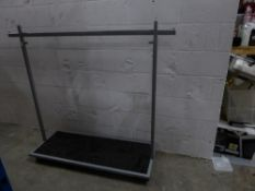 * metal rail with bottom shelf on castors. Adjustable height. 1600w x 500d x 1400h (min)