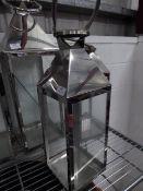 * S/S lantern. 180w x 180d x 550h. Missing 2 glass panels