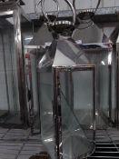 * S/S lantern. 180w x 180d x 550h.