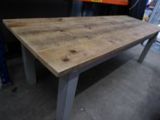 * large wooden farm house table - very solid. With rugged top and painted grey legs. Would seat 10-