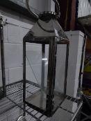 * S/S lantern. 180w x 180d x 510h. Missing 3 glass panels