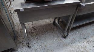 * S/S prep bench on castors. 900w x 600d x 900h