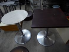 * 3 x tables with chrome bases - 2 x round (white wood effect top - 600d), 1 x square (dark work top
