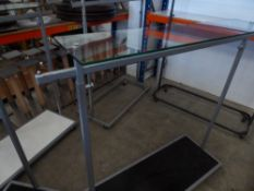 * clothes rail on castors - adjustable height with under shelf and glass over shelf
