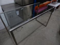 * glass top table with brushed steel frame. 1500w x 650d x 920h