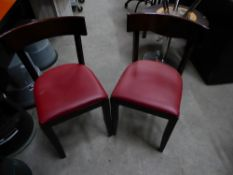 * 8 x wooden chairs with faux red leater upholstered seats