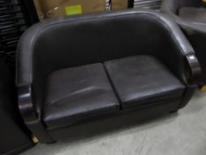 * Brown leather sofa with dark wooden detailing to arms. 1450w x 850d x 850h