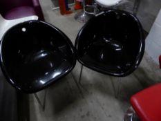 * 2 x black plastic bucket chairs