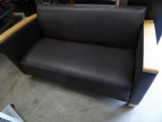 * Brown leather sofa with beech arms and feet. 1450w x 700d x 700h