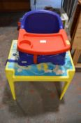 Child's Plastic Table and a Baby Feeding Chair