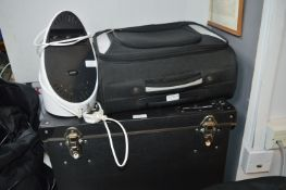 Holly Fiber Box Containing Assorted Mains Leads, Mood Lighter, and Wheeled Travel Bag