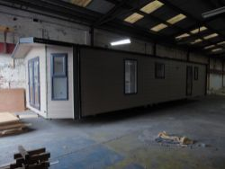 8293 - Auction of New Mobile Home, Industrial Machinery and Bulk Storage Containers