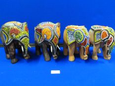 Four Carved Wood Elephants with Beadwork