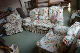 Three Seat Sofa and Two Matching Armchairs with Floral Covers