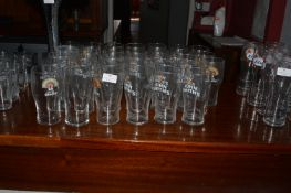 Thirty-Five Johns Smiths Pint Glasses